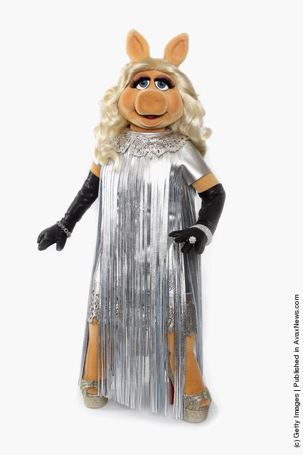 Miss Piggy debuts her dress designed by Giles Deacon for the UK premiere of The Muppets this evening at The Mayfair Hotel
