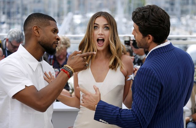 """Cast members Edgar Ramirez (R), Usher Raymond IV and Ana De Armas (C) pose during a photocall for the film """"Hands of stone"""" out of competition at the 69th Cannes Film Festival in Cannes, France, May 16, 2016. (Photo by Jean-Paul Pelissier/Reuters)"""