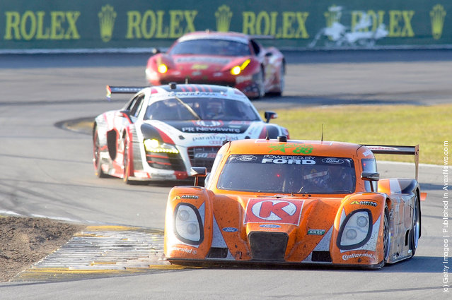 The #77 DP Ford Dallara driven by Brian Fisselle, Burt Frisselle, Jim Lowe and Paul Tracy race into a turn during the Rolex 24