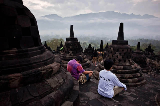 "Indonesian Buddhists pray at Borobudur temple during celebrate Vesak Day, commonly known as ""Buddha's birthday"", at the Borobudur Mahayana Buddhist monument on May 6, 2012 in Magelang, Indonesia. Buddhists in Indonesia celebrate Vesak at the Borobudur temple annually, which makes it the most visited tourist attraction in Indonesia. (Photo by Ulet Ifansasti/Getty Images)"