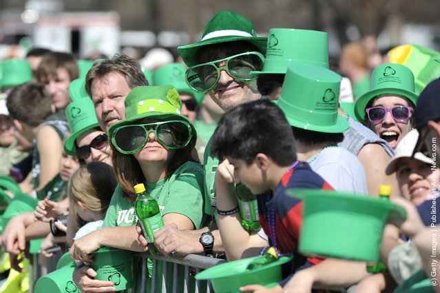 Onlookers watch the St. Patrick's Day parade on March 17, 2012 in Chicago, Illinois
