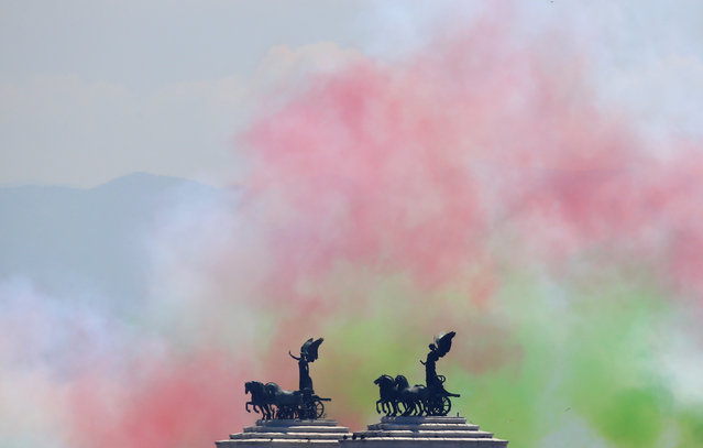 Coloured smoke left by the Italian Frecce Tricolori aerobatic squad is seen after their performance during the Republic Day military parade in Rome, Italy June 2, 2017. (Photo by Tony Gentile/Reuters)