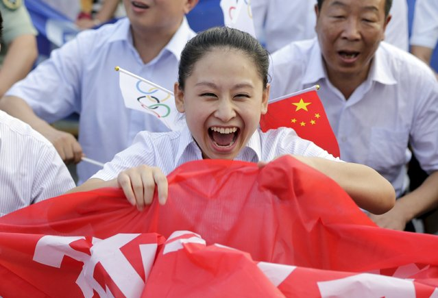 Local resident Zhang Jing celebrates after Beijing was chosen to host the 2022 Winter Olympics at a square in Chongli county of Zhangjiakou, jointly bidding to host the 2022 Winter Olympic Games with capital Beijing, July 31, 2015. Beijing was chosen by the International Olympic Committee (IOC) to host the 2022 Winter Olympics on Friday, becoming the first city to be awarded both summer and winter Games. (Photo by Jason Lee/Reuters)