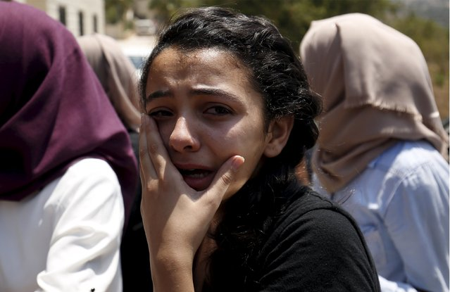 A relative of Palestinian youth Laith al-Khaldi mourns during his funeral near the West Bank city of Ramallah August 1, 2015. (Photo by Mohamad Torokman/Reuters)