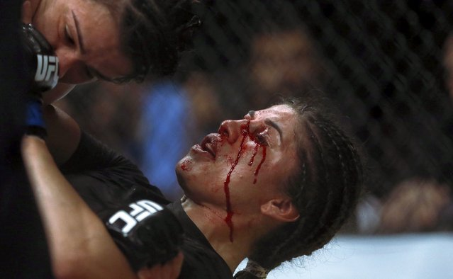 Claudia Gadelha (L) of Brazil fights with Jessica Aguilar of Mexico during their Ultimate Fighting Championship (UFC) match, a professional mixed martial arts (MMA) competition in Rio de Janeiro, Brazil August 1, 2015. (Photo by Ricardo Moraes/Reuters)