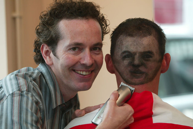 Shane Sutton (28), from Bognor Regis, West Sussex, has had an image of football star Wayne Rooney shaved onto the back of his head by hair stylist Daren Terry (left). (Photo by Southern News & Pictures)