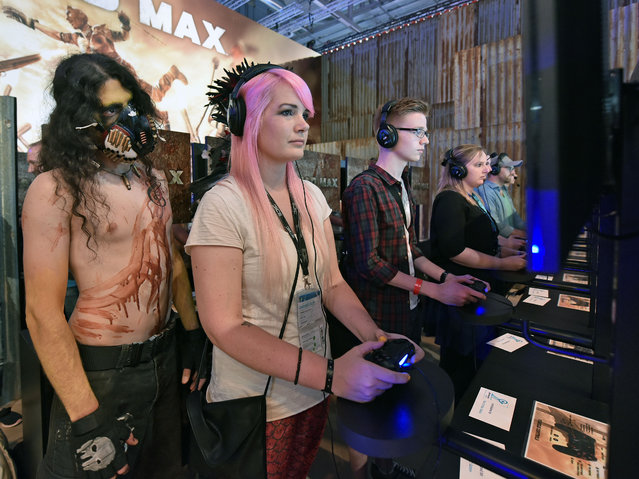 Costumed  participants  play at  the gamescom computer game  fair in Cologne, Germany, Wednesday, August 5, 2015. (Photo by Martin Meissner/AP Photo)