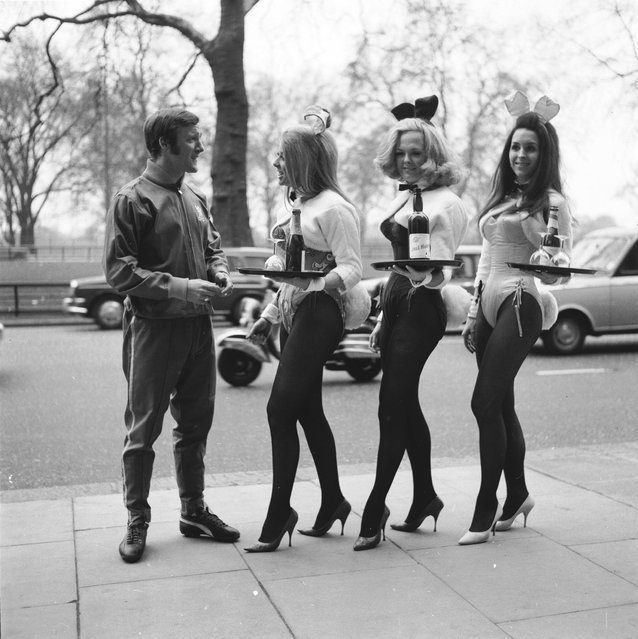 Three Playboy Club Bunny Girls practice their serving during a training session for the All-London Waiter and Waitress Race to be held for charity in Battersea Park, United Kingdom on 24th March 1970.  (Photo by Central Press/Getty Images)