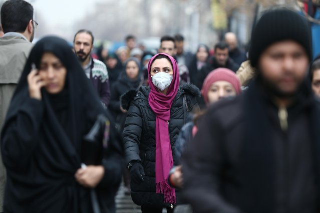 An Iranian woman wearing a protective mask to prevent contracting a coronavirus walks at Grand Bazaar in Tehran, Iran on February 20, 2020. (Photo by Nazanin Tabatabaee/WANA (West Asia News Agency via Reuters)