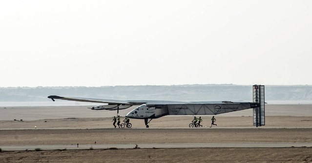 Solar Impulse 2, the solar powered plane, lands at Cairo International Airport on July 13, 2016, for the penultimate stage of its world tour. The experimental plane had completed the first solo transatlantic flight powered only by sunlight to land in Spain last month, and will continue from Cairo to Abu Dhabi, where it began its marathon journey in March last year. (Photo by Khaled Desouki/AFP Photo)