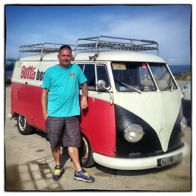 Grant Goree, 39, from Woking poses for a photograph besides his 1958 first generation or T1, split-screen Volkswagen Transporter van in Newquay on August 6, 2014 in Cornwall, England. The van, which he bought for £6000 twelve years ago is an ex-German airport fire truck and is nicknamed Tulula. (Photo by Matt Cardy/Getty Images)