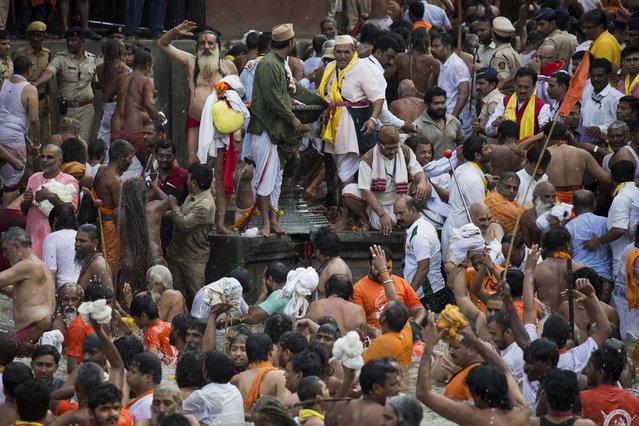 Hindu devotees take a bath in the Godavari River during Kumbh Mela, or Pitcher Festival, in Nasik, India, Saturday, August 29, 2015. (Photo by Bernat Armangue/AP Photo)