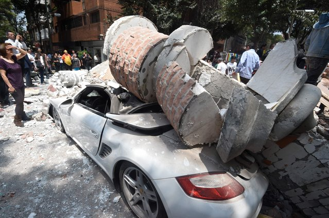 Picture of a car crashed by debris from a damaged building after a quake rattled Mexico City on September 19, 2017. (Photo by Alfredo Estrella/AFP Photo)