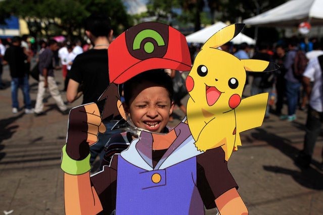 """A fan of the augmented reality mobile game """"Pokemon Go"""" by Nintendo participate in a """"poketour"""" organized by the municipality in San Salvador, El Salvador July 23, 2016. (Photo by Jose Cabezas/Reuters)"""