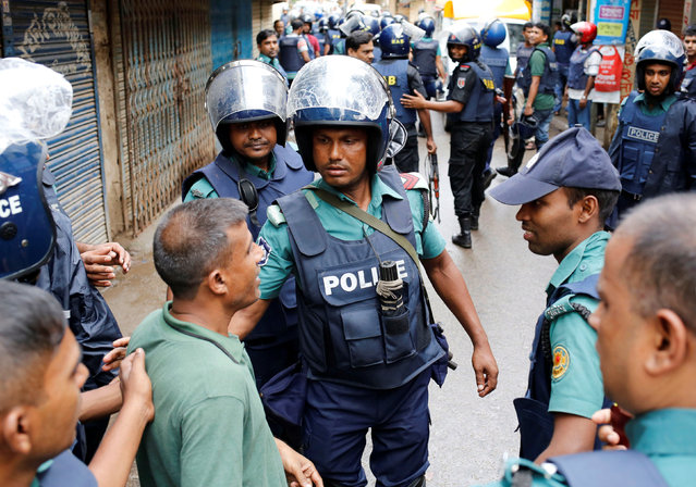 Police keep the public away near the site of a police operation on militants on the outskirts of Dhaka, Bangladesh, July 26, 2016. (Photo by Mohammad Ponir Hossain/Reuters)