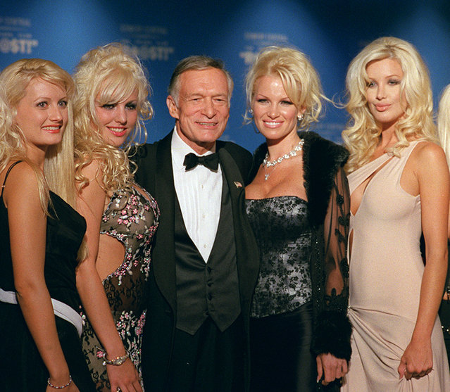 Hugh Hefner, 75, center, poses with four of his girlfriends before the start of The New York Friars Club Roast in New York, September 29, 2001. The New York Friars, a members-only group of entertainers who've poked fun at each other at formal dinners for nearly a century, turned their barbs on the Playboy magazine founder, who was an easy target for his libido and his luxurious lifestyle. A severely edited version of the star-studded, black-tie event is scheduled to air at 10 p.m. EST Sunday on Comedy Central. (Photo by Jim Cooper/AP Photo)