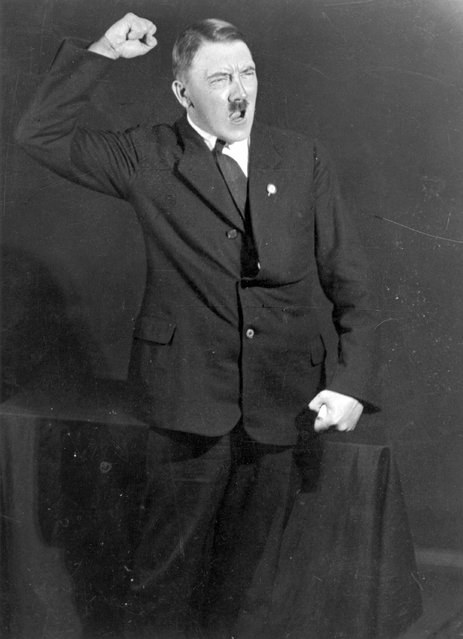 1925: Hitler posing to a recording of one of his speeches after his release from Landsberg Prison. (Photo by Heinrich Hoffmann/Keystone Features)