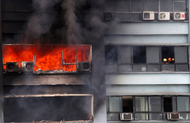 Firefighters battle to extinguish a large fire on 12th floor of the Chatterjee International Centre building in Calcutta, India, September 2, 2014. Reportedly the fire originally started on the 12th floor and slowly extended to other floors. At least twelve fire engines reached the spot and at least four persons were evacuated but noboby was injured. (Photo by Piyal Adhikary/EPA)
