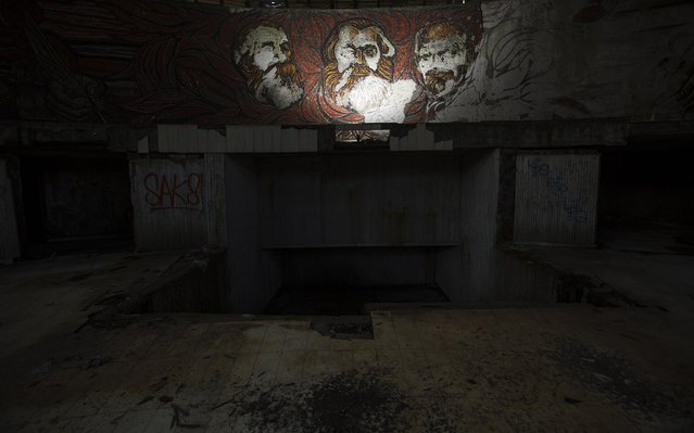 Murals of (L-R) Karl Marx, Friedrich Engels and Vladimir Lenin are seen inside the crumbling main hall of the Memorial House of the Bulgarian Communist Party on mount Buzludzha September 12, 2014. (Photo by Stoyan Nenov/Reuters)