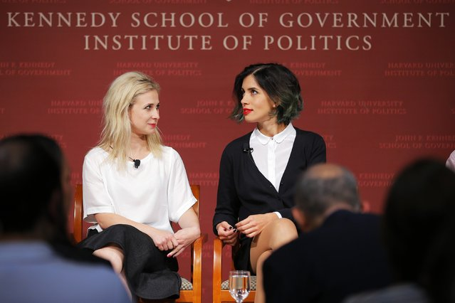 Maria Alyokhina (L) and Nadezhda Tolokonnikova, members of the punk protest band p*ssy Riot, take their seats onstage for a forum at the Kennedy School of Government at Harvard University in Cambridge, Massachusetts September 15, 2014. (Photo by Brian Snyder/Reuters)