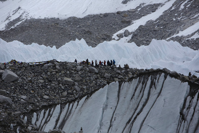 Trekkers stand in Everest Base camp, approximately 17388 feet above sea level, in Solukhumbu District May 6, 2014. (Photo by Navesh Chitrakar/Reuters)