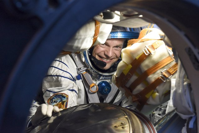Denmark's astronaut Andreas Mogensen smiles inside the landing capsule after landing near the town of Dzhezkazgan (Zhezkazgan), Kazakhstan, in this September 12, 2015 handout picture. (Photo by Stephane Corvaja/Reuters/ESA)