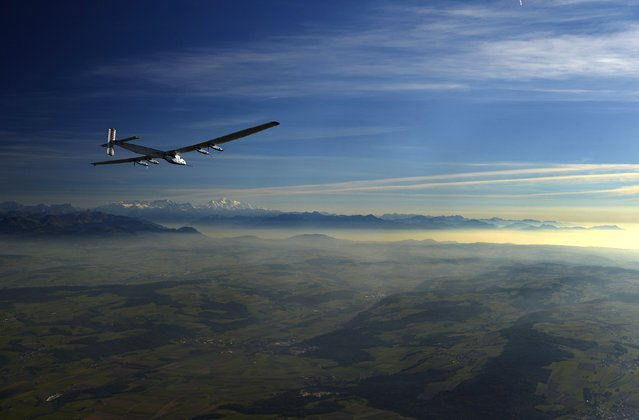 German test pilot Markus Scherdel steers the solar-powered Solar Impulse 2 aircraft during a training flight at its base in Payerne September 27, 2014. The aircraft, which was unveiled April 9, weighs 2.4 tons with a wingspan of 72 meters (236 ft.) and has more than 17,000 solar cells. The attempt to fly around the world in stages using only solar energy will be made from March 2015 starting from Abu Dhabi. (Photo by Denis Balibouse/Reuters)