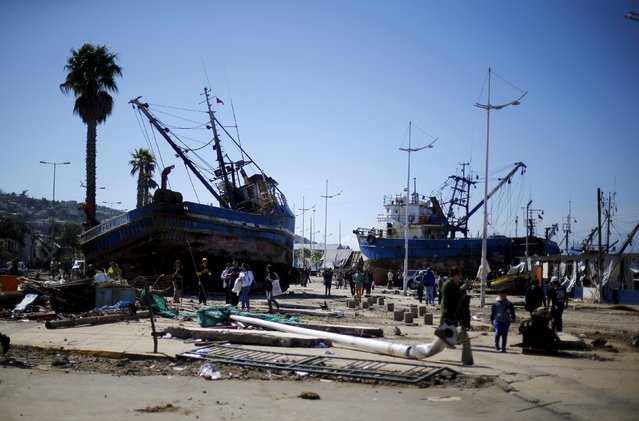 Ships are seen on the street after an earthquake hit areas of central Chile, in Coquimbo city, north of Santiago, Chile, September 17, 2015. Residents sifted through rubble on Thursday and saved what they could from homes destroyed by a magnitude 8.3 earthquake in central Chile that killed 11 people, forced 1 million from their homes and sent giant waves crashing into coastal areas. (Photo by Ivan Alvarado/Reuters)