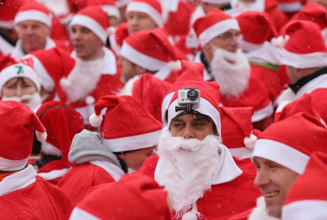Participants dressed as Santa Claus, including one with a GoPro camera on his head, gather shortly before the 4th annual Michendorf Santa Run (Michendorfer Nikolauslauf) on December 9, 2012 in Michendorf, Germany. Over 800 people took part in this year's races that included children's and adults' races.  (Photo by Sean Gallup)