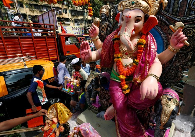 Idols of the Hindu god Ganesh, the deity of prosperity, are transported to places of worship on the first day of the Ganesh Chaturthi festival in Mumbai, India, September 5, 2016. (Photo by Danish Siddiqui/Reuters)