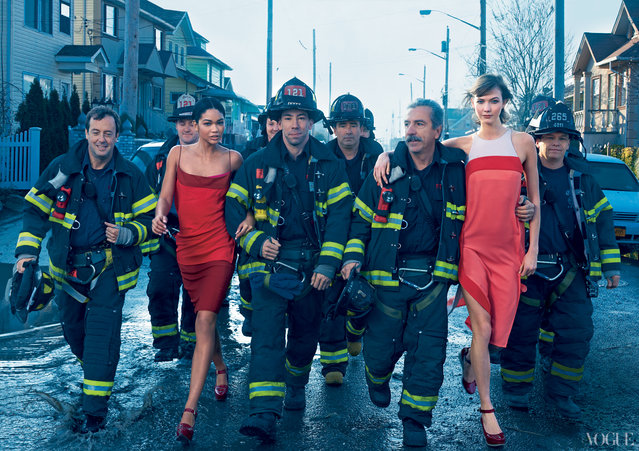 Models Chanel Iman and Karlie Kloss pose with the FDNY on Yanuary, 2013. (Photo by Annie Leibovitz/Vogue)