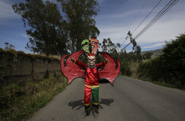 "Dressed for the traditional New Year's festival known as ""La Diablada"", in Pillaro, Ecuador, Friday, January 5, 2018. (Photo by Dolores Ochoa/AP Photo)"