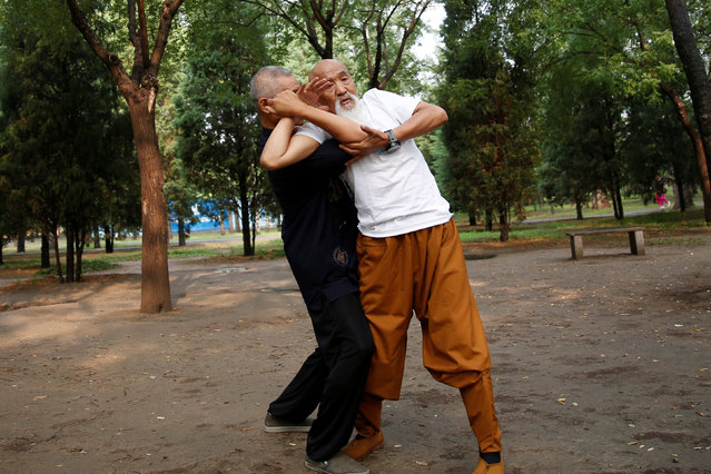 Kung Fu master Li Liangui (R) practices with his friend at a park in Beijing, China, June 30, 2016. (Photo by Kim Kyung-Hoon/Reuters)