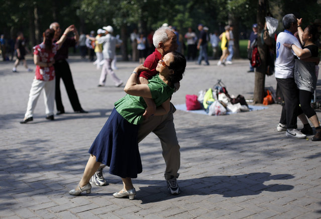 Locals dance during a morning exercise session at the Temple of Heaven park in Beijing. (Photo by Grace Liang/Reuters)