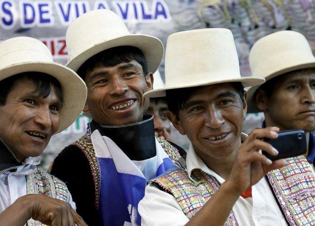 "Residents attend at the inauguration of a sports arena called ""Coliseo Ban Ki-Moon"" in Vila Vila, south of Cochabamba, October 11, 2015. (Photo by David Mercado/Reuters)"
