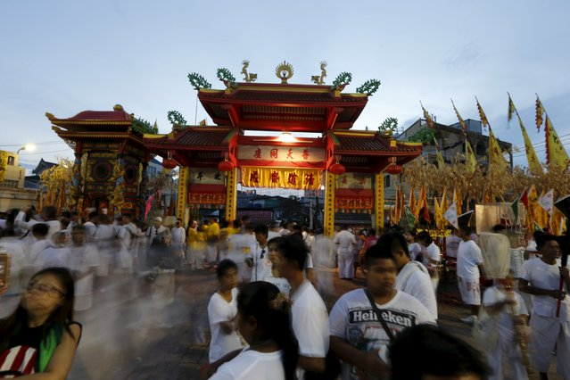 Devotees of the Chinese Jui Tui shrine waits at the start of a procession celebrating the annual vegetarian festival in Phuket, Thailand October 19, 2015. (Photo by Jorge Silva/Reuters)