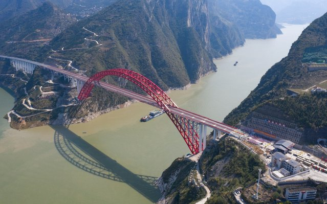 Aerial view of the Zigui Yangtze River Bridge after officially opening on September 27, 2019 in Yichang, Hubei Province of China. The 883.2-meter-long bridge connects three scenic spots including Three Gorges, Shennongjia and Wudang Mountain. (Photo by VCG/VCG via Getty Images)