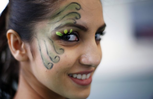 Miss India Koyal Rana wears face paint during the Miss World sports competition at the Lee Valley sports complex in north London, November 26, 2014. (Photo by Andrew Winning/Reuters)