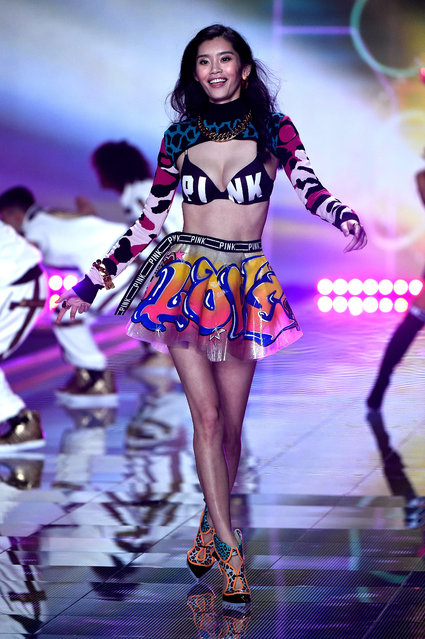 Model Ming Xi walks the runway at the annual Victoria's Secret fashion show at Earls Court on December 2, 2014 in London, England. (Photo by Pascal Le Segretain/Getty Images)