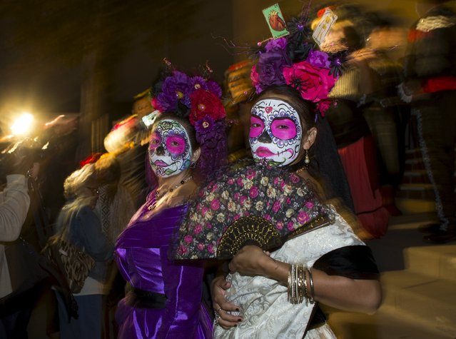 "Participants gather before the start of a candlelight procession at the end of a three-day ""Day of The Dead"" (Dia de los Muertos) celebration in Old Town San Diego, California November 2, 2015. (Photo by Mike Blake/Reuters)"