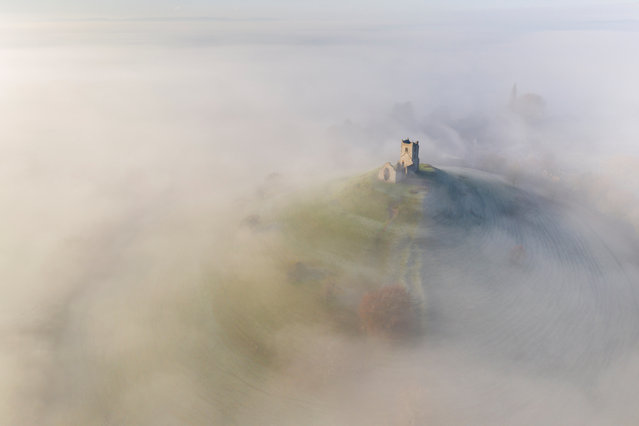 Winner: Historic England, St Michael's Church. St Michael's church on Burrow Mump, surrounded by a blanket of mist. Burrowbridge, Somerset, England. December 2019. (Photo by Adam Burton/Historic Photographer of the Year 2020)