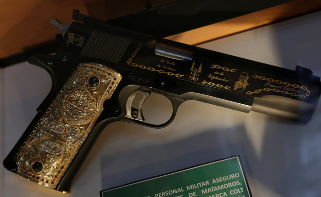 A gun decorated with gold belonging to Mexican drug lord of the Gulf Cartel Osiel Cardenas Guillen is displayed in the Drugs Museum, used by the military to showcase to soldiers the lifestyles of Mexican drug lords, at the headquarters of the Ministry of Defense in Mexico City, October 14, 2016. (Photo by Henry Romero/Reuters)