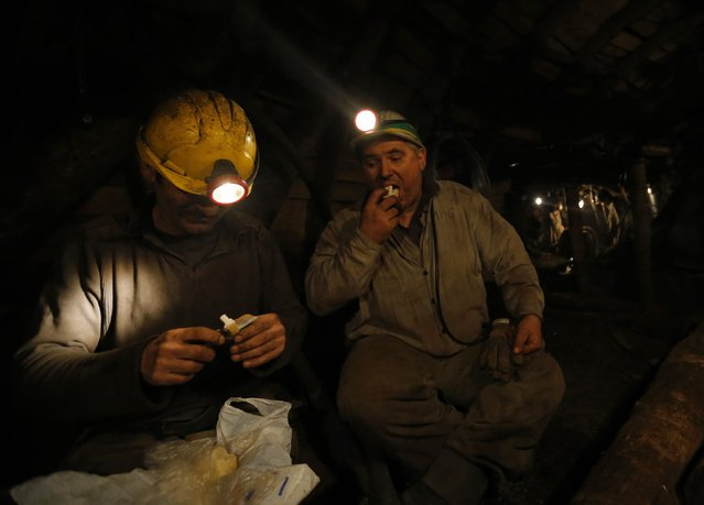 Miners eat during their last working day at Hungary's last hard coal deep-cast mine at Markushegy December 23, 2014. (Photo by Laszlo Balogh/Reuters)