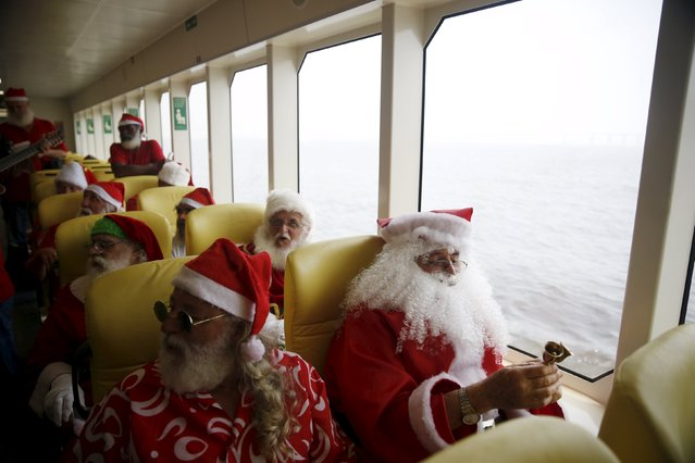 "Students of the ""Escola de Papai Noel do Brasil"" (Brazil's school of Santa Claus)  travel on a ferry through Guanabara bay, during their graduation ceremony in Rio de Janeiro, Brazil, November 10, 2015. (Photo by Pilar Olivares/Reuters)"