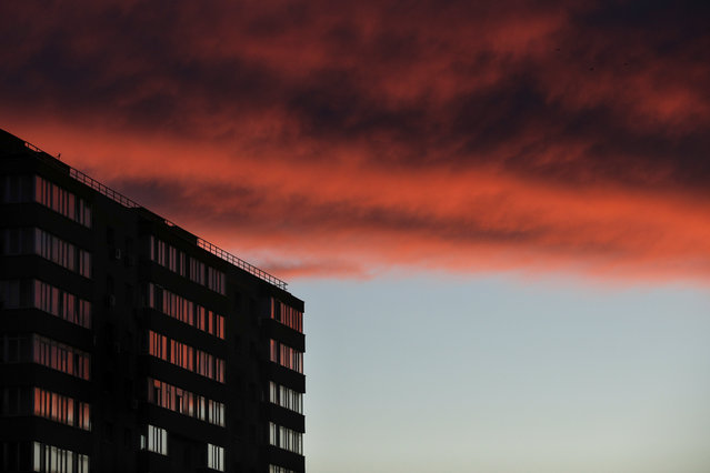 Sunset over a communist-era block of flats in Bucharest, Romania, October 13, 2020. (Photo by Octav Ganea/Inquam Photos via Reuters)