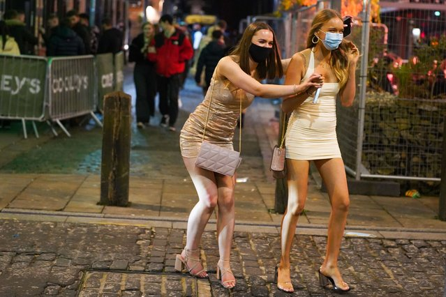 Ladies enjoyed themselves last night – while keeping safe with their face masks on in Liverpool, United Kingdom on Saturday, December 5, 2020, after coronavirus restrictions were eased following the end of the second national lockdown. (Photo by London News Pictures)