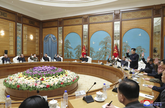"In this photo provided by the North Korean government, North Korean leader Kim Jong Un, center, attends a meeting of the ruling Workers' Party Politburo in Pyongyang, Tuesday, December 29, 2020. Kim has reviewed the agenda for a ruling party congress set for early next month, state media reported Tuesday, dispelling outside speculation the North might delay the meeting due to the COVID-19 pandemic. Independent journalists were not given access to cover the event depicted in this image distributed by the North Korean government. The content of this image is as provided and cannot be independently verified. Korean language watermark on image as provided by source reads: ""KCNA"" which is the abbreviation for Korean Central News Agency. (Photo by Korean Central News Agency/Korea News Service via AP Photo)"