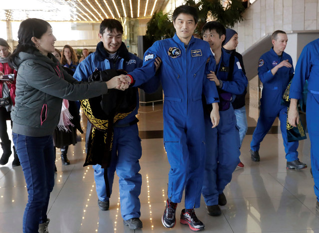 International Space Station (ISS) crew member Takuya Onishi of Japan is assisted by Japan Aerospace Exploration Agency (JAXA) specialists upon his arrival at the airport in Karaganda, Kazakhstan, October 30, 2016. (Photo by Dmitri Lovetsky/Reuters)