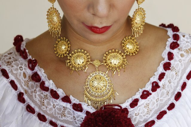 "A woman wears golden jewelry, part of the traditional clothing known as ""Pollera"", before the annual Thousand Polleras parade in Las Tablas, in the province of Los Santos January 10, 2015. (Photo by Carlos Jasso/Reuters)"