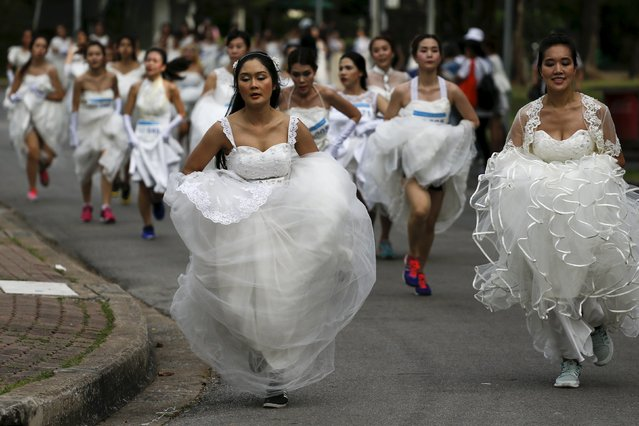 "Brides-to-be participate in the ""Running of the Brides"" race in a park in Bangkok, Thailand, November 28, 2015. (Photo by Athit Perawongmetha/Reuters)"